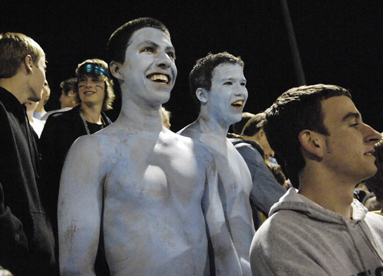 Lakeridge seniors Amador Marcano (left) and Cody Palmer (right) show their spirit as they brave the chilly Fall evening air as they wear only Lakeridge Columbia blue body paint to cover their upper body.
