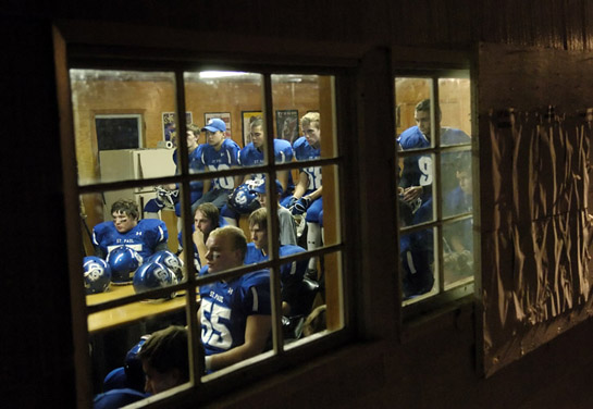 The St. Paul Buckaroos gather in the cottage adjacent to the rodeo arena for their pre-game talk as they prepare to take on league rival Perrydale Pirates.