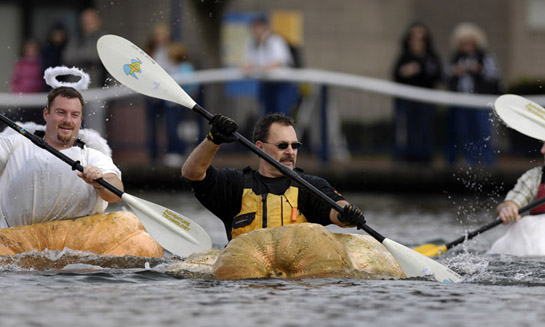 Giant pumpkin grower Mel Gandee of Estacada, Oregon paddles his way towards the front of the pack in the early going of the growers' race during the West Coast Giant Pumpkin Regatta.