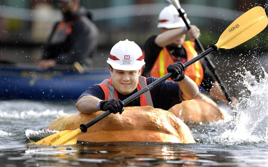 Matt Hess of the U.S. Army Corps of Engineers paddles his way across the Lake at the Commons in Tualatin, Oregon as he and other corps members particpate in a challenge race against city of Tualatin employees.
