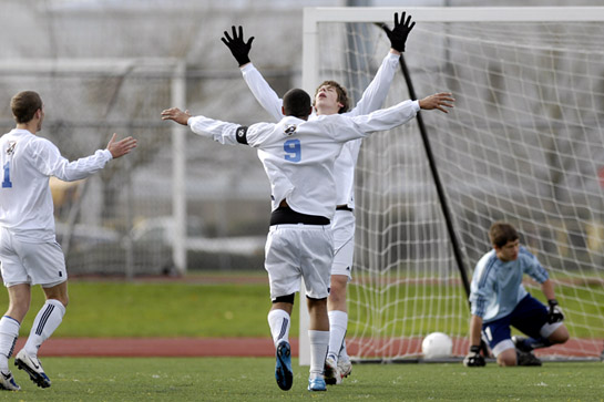 Zane Meehan of Corvallis throws his arms into the air in celebration after converting a penalty kick that put the Spartans into the lead for good at 2-1 with 8:05 left in the match after a deliberate hand ball in the box resulted in the sending off of Mt. View's Mike Wood.