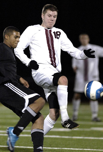 Eirik Sagstad (right) of Glencoe challenges Corvallis midfielder Jamal Abdoul for a ball during first half play.
