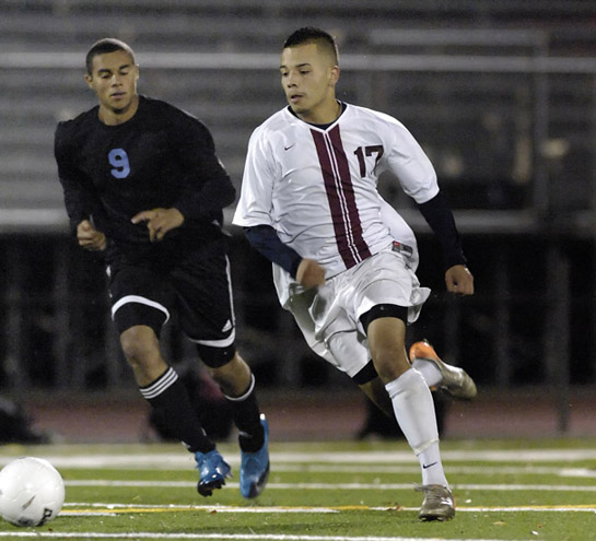 David Cazares of Glencoe sprints through midfield during a second half break.