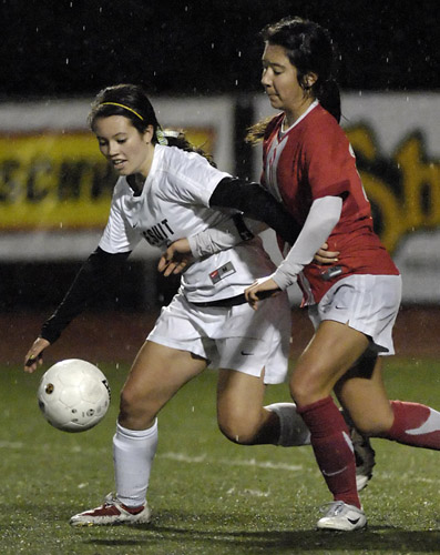 Alison Martin (left) of Jesuit beats Westview's Desiree Tyner (right) to the ball in midfield during second half action.