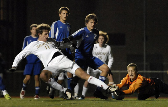 Cameron French lays out full stretch as he hits a first-time ball off a free kick from the edge of the box in an attempt to score.  His shot was blocked by South Medford keeper Mitch North, however the ball rebounded to the back post where South Salem's Ethan Jones tucked it into the net for the game winning goal.