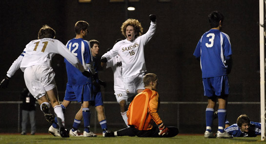 Ethan Jones of South Salem cellebrates his game winning goal as South Medford keeper and his defensive players look hopelessly at the ball resting in their goalnet. 
