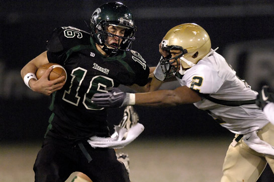 West Salem quarterback Brett Smith (left) is stopped by Jesuit's Keanon Lowe (right) after rushing 11 yards for a first down early in the third quarter.