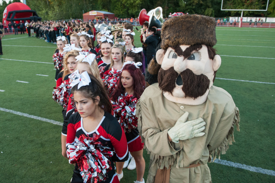 Oregon City vs Central Catholic OSAA 6A Football - Pioneer Stadium, Oregon City, Oregon - Oregon City mascot and cheerleaders during the playing of The National Anthem.