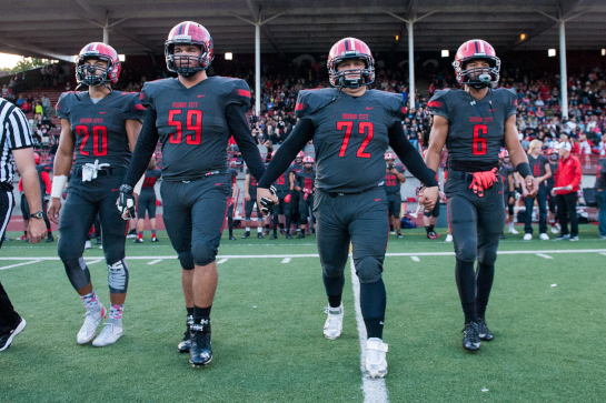 Oregon City vs Central Catholic OSAA 6A Football - Pioneer Stadium, Oregon City, Oregon - Oregon City captains Kiahve Dennis-Lee (20), Aaron Parker (59), Duncan Cranston (72) and Trevon Bradford (6).