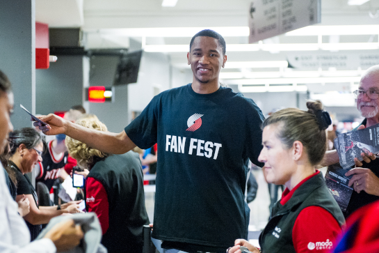 Portland Trailblazer guard Luis Montero greets fans as they enter the Moda Center for Fan Fest 2015.