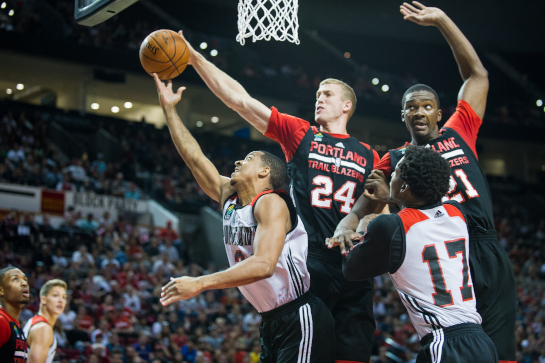 Trailblazer forward Mason Plumlee (24) blocks the layup attempt by CJ McCollum (3) during the first quarter of the Blazer Fan Fest scrimmage. Also pictured are Noah Vonleh (21) and Ed Davis (17).