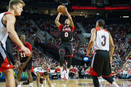Trailblazer guard Damian Lillard (0) shoots a jumper in the lane during the third quarter of the Fan Fest scrimmage.
