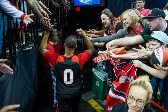 Trailblazer guard Damian Lillard greats fans as he exists the Moda Center court following Fan Fest scrimmage.