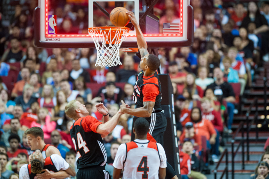 Trailblazer guard Damian Lillard dunks the ball at the buzzer ending the first quarter. The basket counted as referees did not have the benefit of instant replay during the Fan Fest scrimmage.