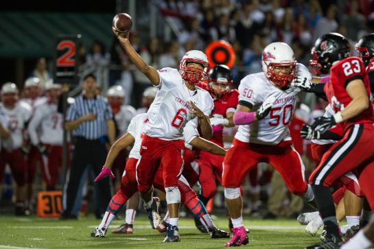 Centennial quarterback Mychael Kane (6) throws a screen pass to Jesse Porter during a second quarter drive.