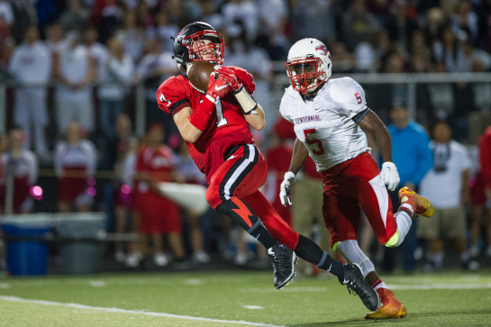 Clackamas wide receiver David Benintendi (7) pulls down a 45 pass completion down to the eleven yard line of Centennial with 4:06 left in the second quarter.
