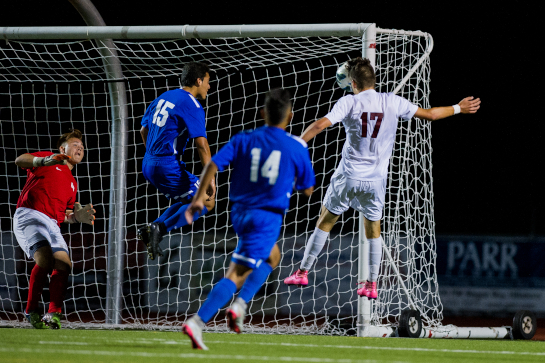 Glencoe midfielder Noah Spellman (17) heads the ball into the net off the far post cross past Hillsboro defenders Luis Guevara (15), Juan Pedro Moreno Olmeda (14) and goalkeeper Jose Rodriquez (in red). Spellman's goal gave the Tide a 1-0 lead with 27:51 left in the second half of the match.