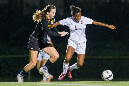 Milwaukie midfielder Noelani McGowan (1) dribbles the ball under pressure from Rex Putnam midfielder Megan Spaulding (11).