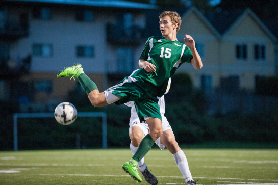 Rex Putnam defender Drew Urben (15) reaches to control the ball during the second half.