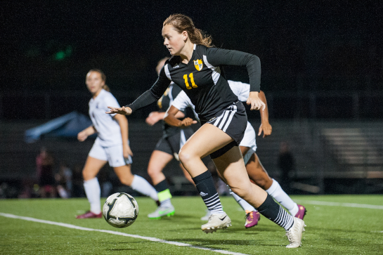 Rex Putnam midfielder Megan Spaulding (11) dribbles the ball forward during the second half.