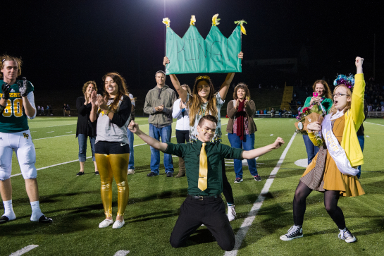 Rex Putnam Senior Keegan Brooks (kneeling) celebrates as he is proclaimed Homecoming King for 22015.