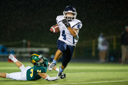 Liberty running back Minoo Ha (4) slips past Rex Putnam linebacker Ammon Rial (44) in the backfield as he goes on for a 13 yard gain during the third quarter.