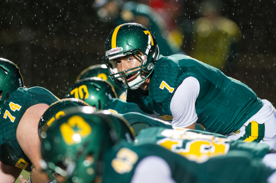 Rex Putnam quarterback Jake Hamilton (7) readies for the snap during a third quarter drive.