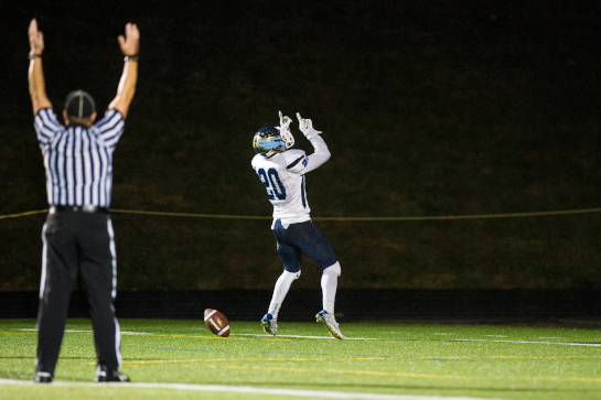 Liberty running back Charles Clark (20) celebrates his 36 yard touchdown run with 1:12 to go in the third quarter.