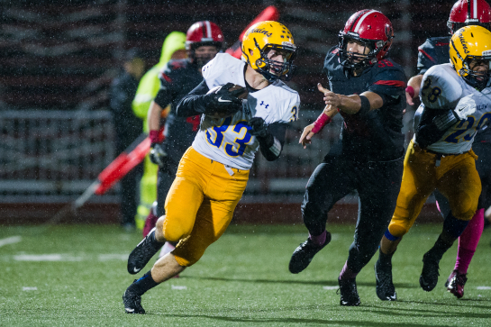 Barlow running back Wyatt Radke (33) pursued by Oregon City defensive end Brandon Dillon (36) on a kickoff return during the second quarter.