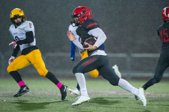 Oregon City running back Connor Mitchell (5) runs the ball 70 yards down to the Barlow two yardline to set up his touchdown run on the following play with fifteen seconds remaining in the second quarter.