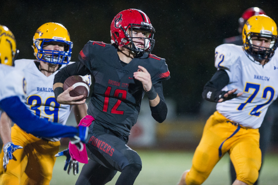 Oregon City quarterback Riley Rexine (12) runs for a 56 yard touchdown with 7:15 remaining in the fourth quarter.