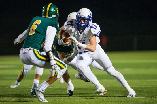 La Salle wide receiver Parker Cardwell (11) runs for a ten yard gain before being tackled by Rex Putnam defensive back Joseph Jesse (6) and Brice McDonald (behind) during the Falcons' late fourth quarter scoring drive.