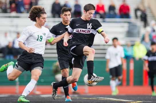 Glencoe midfielder Vladimir Romano (14) dribbles the ball under pressure from West Salem midfielder Gabriel Linares (19) late in the first half.