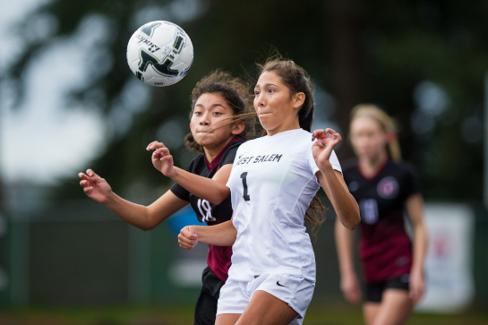 West Salem midfielder Liz Mendez (1) focuses on the ball to bring it under control under pressure from Glencoe midfielder Erika Ganzales Moreno (18) in the first half.