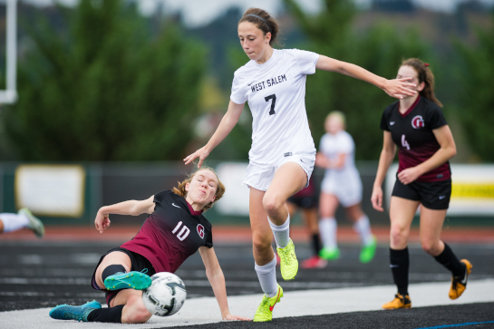 Glencoe midfielder Olivia Dendinger (10) dispossesses West Salem midfielder Paula-Marie Labate (7) with a sliding tackle in midfield during the first half.