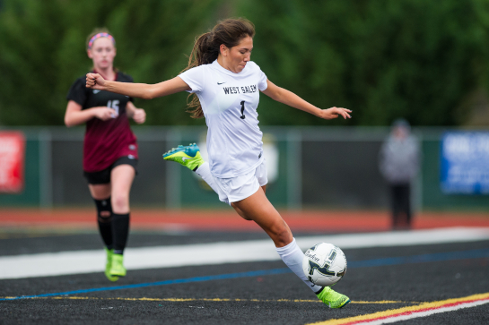 West Salem midfielder Liz Mendez (1) plays the ball forward during the first half.