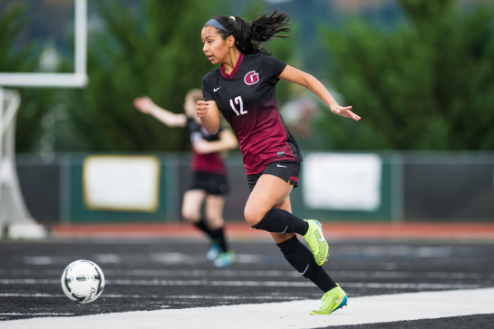 Glencoe midfielder Celeste Molina Sanchez (17) dribbles the ball during a second half attack.  The Crimson Tide freshman scored a brace giving Glencoe its 2-1 playoff victory over the Titans.