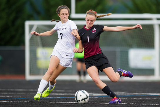 West Salem midfielder Paula-Marie Labate (7) and Glencoe defender Peyton Bell (1) battle for possession in the second half.