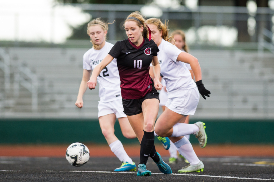 Glencoe midfielder Olivia Dendinger (10) dribbles the ball into the attacking third chased by West Salem defender Raine Loewen-Thomas (12) and Loryn Silbernagel (16) in the second half.